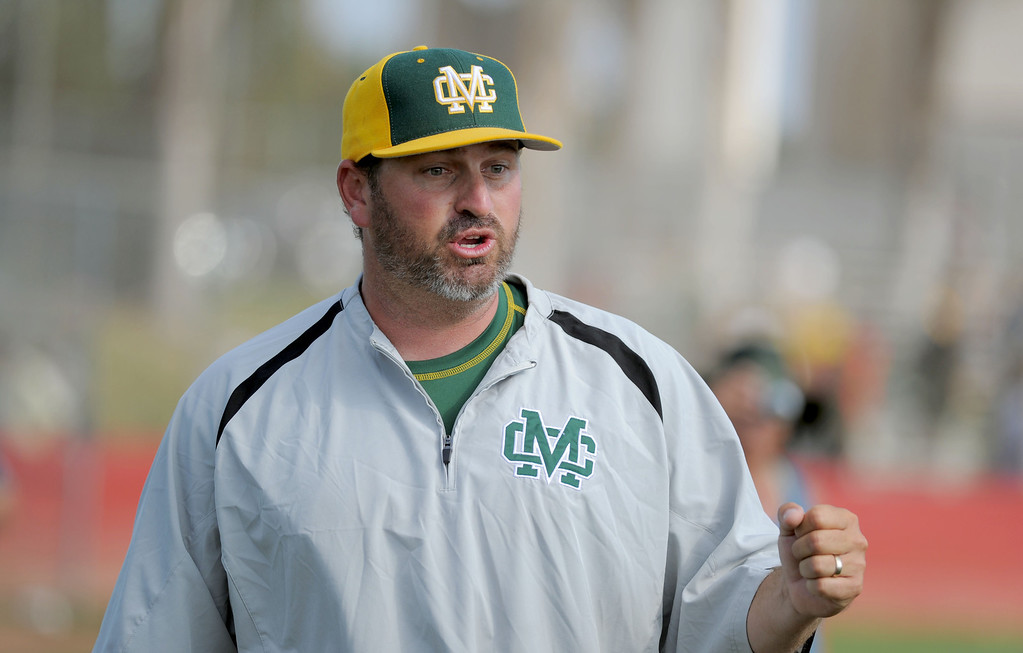 . 05-28-2013-( Sean Hiller/LANG) Mira Costa beat Elsinore 5-3 in Tuesday\'s CIF Southern Section Division III semifinal at Elsinore High School. Cassidy Olson coaching his way to victoryl.