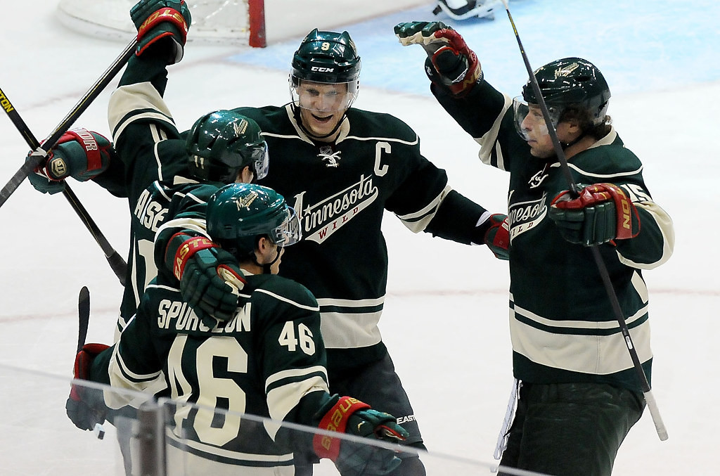 . Minnesota Wild\'s Jared Spurgeon, Zach Parise, Mikko Koivu and Dany Heatley celebrate Parise\'s goal during the third period. (Pioneer Press: Sherri LaRose-Chiglo)