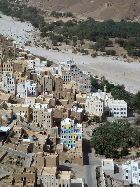 painted mud brick buildings in the wadi