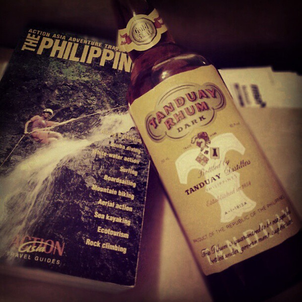 Going_through_an_old_box_from_when_I_lived_in_the_Philippines_in_1999._Not_sure_if_I_m_more_shocked_I_hadn_t_already_drank_the_rum_or_that_I_actually_had_an_adventure_travel_guide..jpg