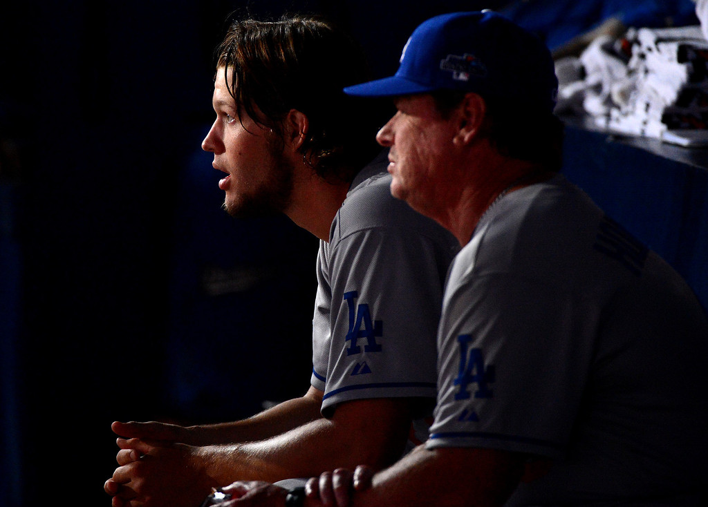 . Los Angeles Dodgers\' pitching coach Rick Honeycutt sits with pitcher Clayton Kershaw during the eighth inning as they defeat the Atlanta Braves 6-1 in the first game of the playoffs Thursday, October 3, 2013 at Turner Field in Atlanta, Georgia. (Photo by Sarah Reingewirtz/Pasadena Star- News)