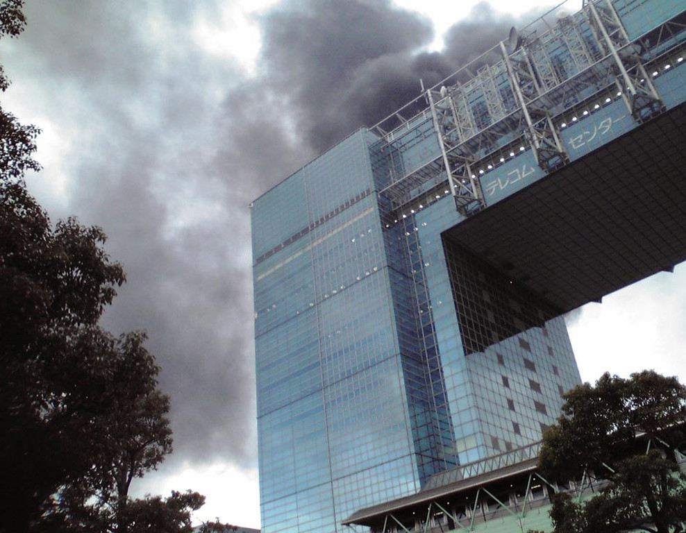 . Black smoke rises from a burning building in Tokyo\'s Odaiba area in Tokyo Bay area after Japan was struck by a magnitude 8.9 earthquake off its northeastern coast Friday, March 11, 2011. (AP Photo/Kyodo News)
