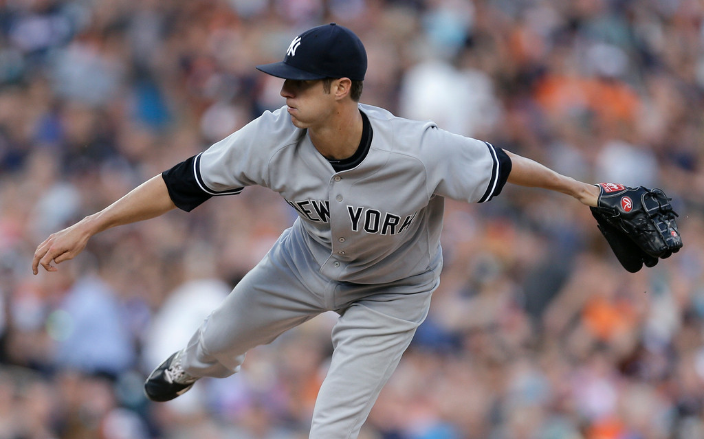 . New York Yankees pitcher Shane Greene throws against the Detroit Tigers in the first inning of a baseball game in Detroit, Wednesday, Aug. 27, 2014. (AP Photo/Paul Sancya)
