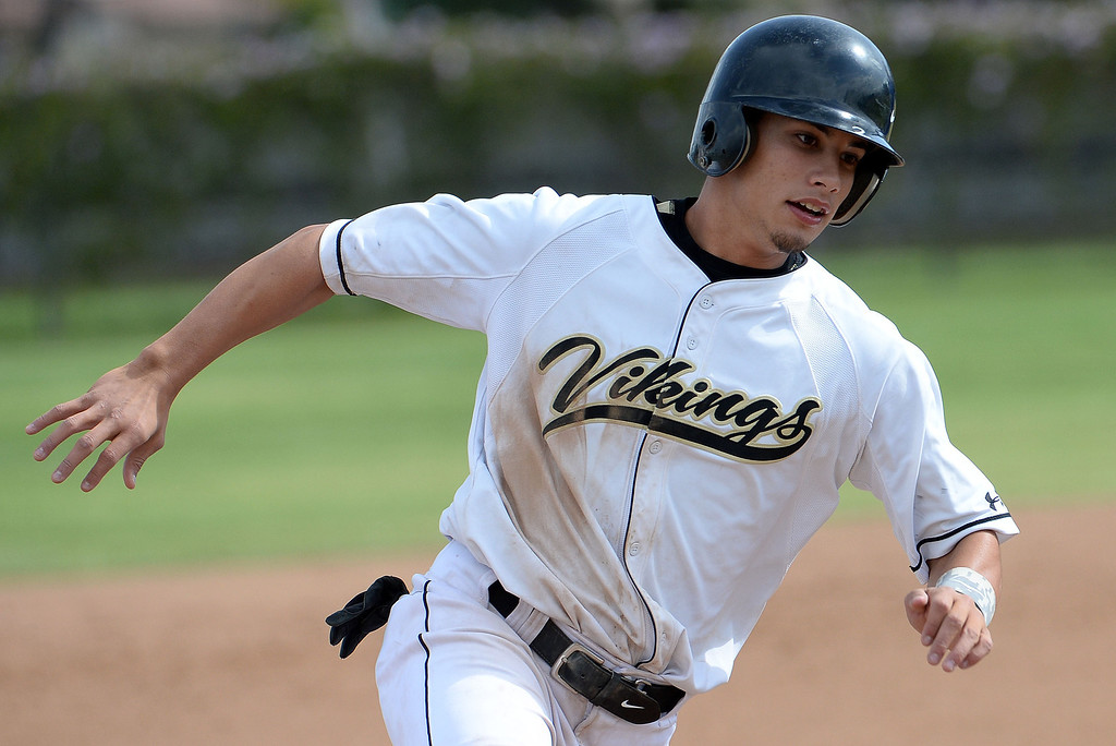 . Northview\'s Jacob Amaya moves to third on a single by Nick Ybarra 9not pictured) in the first inning of a prep baseball game against San Dimas at Northview High School in Covina, Calif., on Wednesday, March 26, 2014. San Dimas won 2-0. (Keith Birmingham Pasadena Star-News)