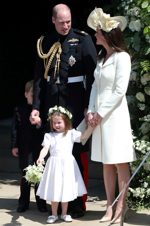 . Britain\'s Prince William and Kate, Duchess of Cambridge with Prince George and Princess Charlotte leave St George\'s Chapel in Windsor Castle after the wedding of Prince Harry and Meghan Markle at St. George\'s Chapel in Windsor Castle in Windsor, near London, England, Saturday, May 19, 2018. (Andrew Matthews/pool photo via AP)