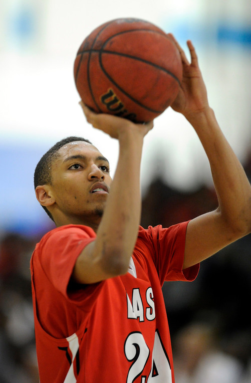 . DENVER, CO. - FEBRUARY 16: East guard Dominique Collier converted free-throws in the second half. The Denver East High School boy\'s basketball team defeated George Washington 82-20 Saturday afternoon, February 16, 2013.  (Photo By Karl Gehring/The Denver Post)