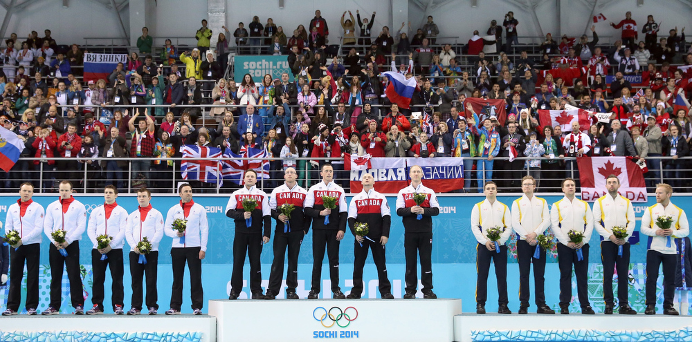 . Silver medalists team Great Britain (L), gold medalists team Canada (C) and bronze medalists team Sweden (R) during the flower ceremony of the men\'s Curling competition in the Ice Cube Curling Center at the Sochi 2014 Olympic Games, Sochi, Russia, 21 February 2014.  EPA/TATYANA ZENKOVICH