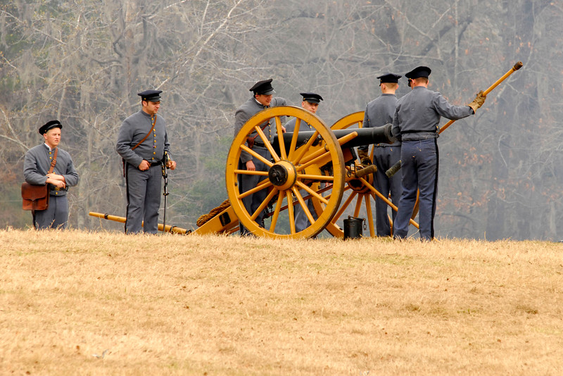 Citadel reenactors prepare their mustard-yellow 6-pound Howitzer. The Skirmish at Gamble's Hotel happened on March 5, 1885 when 500 federal soldiers, under the command of Reuben Williams of the 12th Indiana Infantry, marched into Florence to destroy the railroad depot but were met by Confederate soldiers backed up with 400 militia. The reenactment, held by the 23rd South Carolina Infantry, was held at the Rankin Plantation in Florence, South Carolina on Saturday, March 5, 2011. Photo Copyright 2011 Jason Barnette