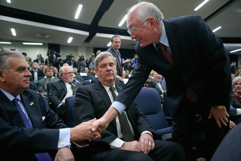 . Interior Secretary Ken Salazar (R) greets Transportation Secretary Ray LaHood (L) and Agriculture Secretary Tom Vilsack after arriving for a ceremony where U.S. President Barack Obama signed a series of executive orders laying out the administration\'s new gun law proposals in the Eisenhower Executive Office building January 16, 2013 in Washington, DC. Salazar announced that he will be leaving the administration and returning to Colorado at the end of March. One month after a massacre that left 20 school children and 6 adults dead in Newtown, Connecticut, the president unveiled a package of gun control proposals that include universal background checks and bans on assault weapons and high-capacity magazines.  (Photo by Chip Somodevilla/Getty Images)
