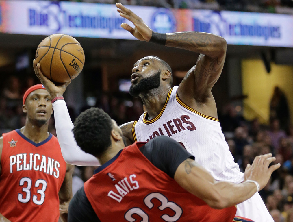 . Cleveland Cavaliers\' LeBron James, right, is called for an offensive foul against New Orleans Pelicans\' Anthony Davis in the first half of an NBA basketball game, Monday, Jan. 2, 2017, in Cleveland. (AP Photo/Tony Dejak)