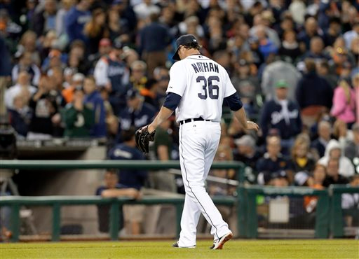 . Detroit Tigers relief pitcher Joe Nathan walks to the dugout after being relieved against the Minnesota Twins in ninth inning of a baseball game in Detroit, Friday, June 13, 2014. Nathan walked Twins\' Eduardo Escobar with the bases loaded. (AP Photo/Paul Sancya)