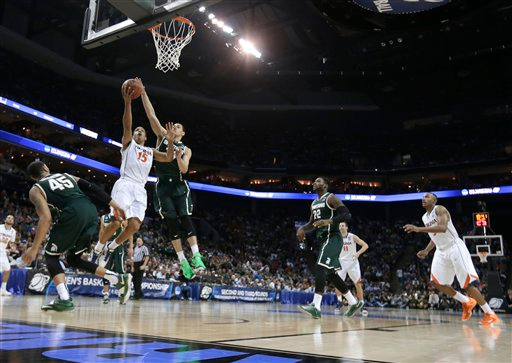 . Virginia\'s Malcolm Brogdon (15) drives to the basket against Michigan State during the second half of an NCAA tournament college basketball game in the Round of 32 in Charlotte, N.C., Sunday, March 22, 2015. Michigan State won 60-54. (AP Photo/Gerald Herbert)