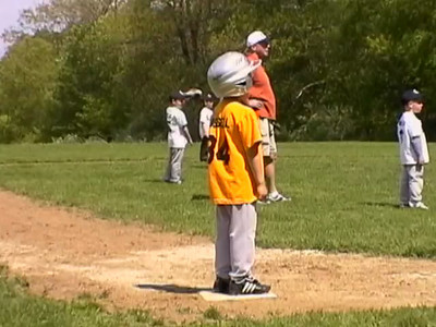 Evan playing T-Ball