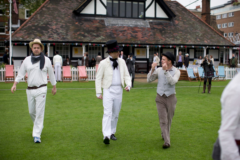 . Players walk out to pose for photographs for the media before the start of a Victorian-era costume themed cricket match on a wicket in Vincent Square, central London, Wednesday, May 29, 2013. The two-over-a-side Victorian match was held Wednesday to mark the launch of the 150th anniversary edition of the Wisden Cricketers\' Almanac.  (AP Photo/Matt Dunham)