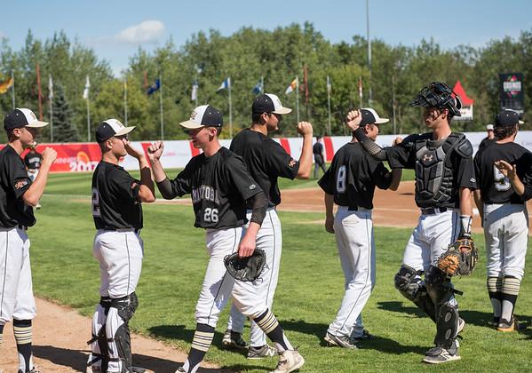 DAVID LIPNOWSKI / WINNIPEG FREE PRESS  Team Manitoba high fives during their semifinal Canada Summer Games baseball game against Alberta Thursday August 3, 2017 at Shaw Park.