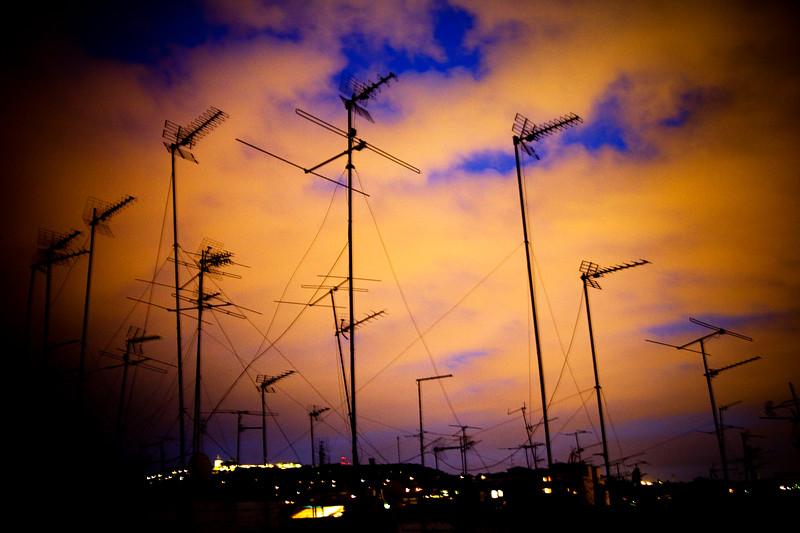 Television antennae over a dusk sky, town of Barcelona, autonomous commnunity of Catalonia, northeastern Spain