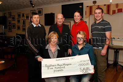 Saval GFC who Organised a charity football match at Christmas in aid of Newry Hospice and raised £500, Committee members present the cheque to Marianne Quinn (hospice) front left, included are back l-r Eddie Lennon (chairman), Vincent Dobbin (president), Ciara Sands (and Cormac Canavan (committee), and Niamh Lennon (pro) seated right, 07W4N51