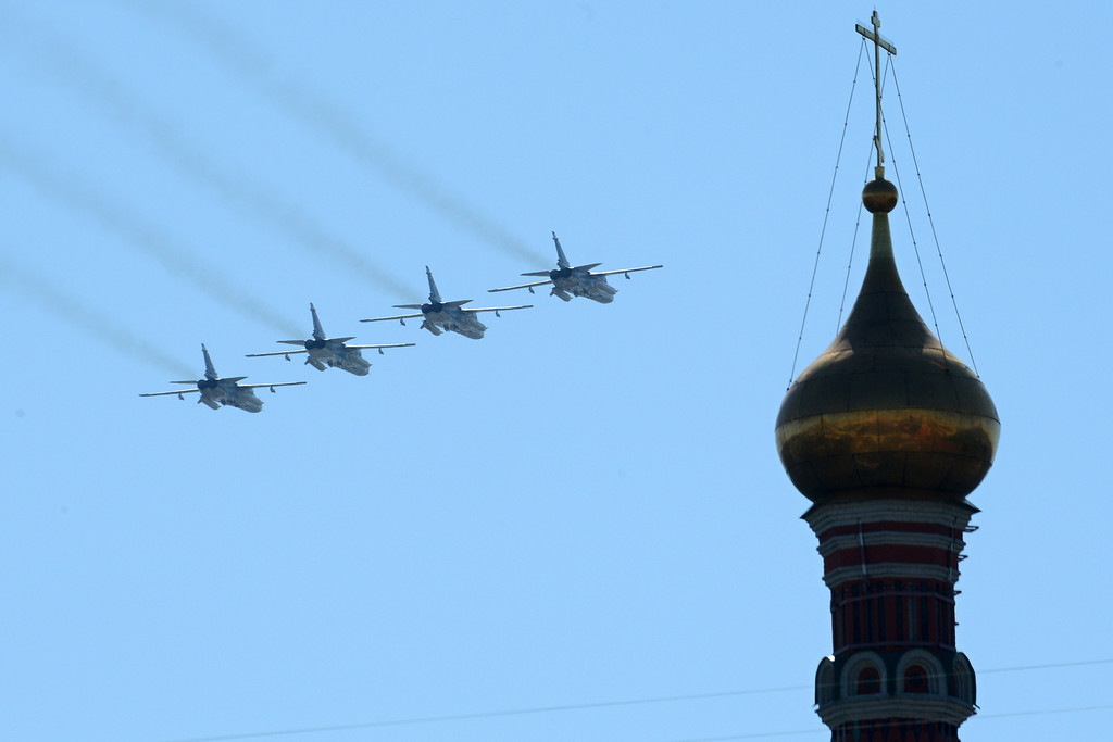 . Russian Sukhoi Su-24 all-weather attack aircraft fly above the Kremlin\'s cathedrals in Moscow, on May  9, 2014, during a Victory Day parade.  AFP PHOTO / KIRILL KUDRYAVTSEV/AFP/Getty Images