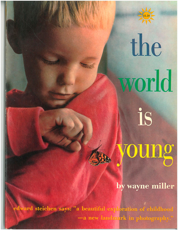 """. This undated photo shows the cover of \""""The World Is Young,\"""" a book published in 1958 by renowned American photographer Wayne F. Miller. Miller, who produced some of the most indelible combat images of World War II and created a ground-breaking series of portraits chronicling the lives of black Americans in Chicago, died Wednesday, May 22, 2013 at age 94. Miller served with an elite Navy unit in the Pacific and took some of the first pictures of Hiroshima, Japan, after it was devastated by the first atomic bomb.  He returned home to his native Chicago and spent two years on the city\'s South Side capturing the experiences of black residents. (AP Photo)"""