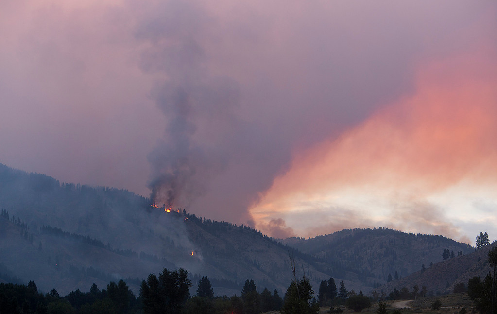 . The Elk fire burns near Pine, Idaho Wednesday Aug. 14, 2013. The Elk fire has burned 111,977 acres and was 10% contained as of 8 am.  (AP Photo/Idaho Statesman, Kyle Green)