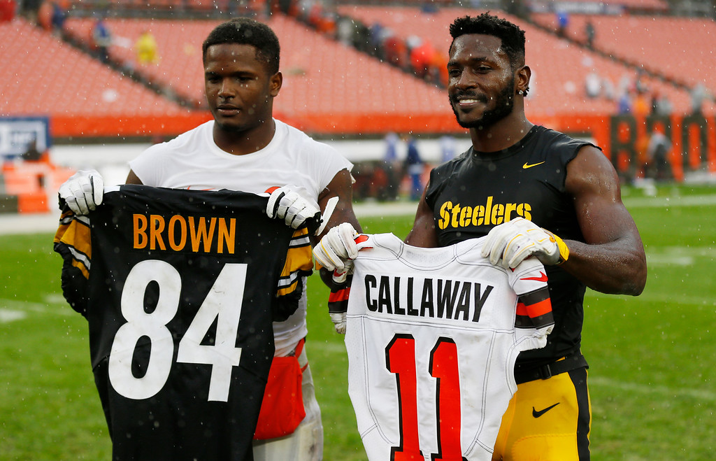 . Pittsburgh Steelers wide receiver Antonio Brown, right, and Cleveland Browns wide receiver Antonio Callaway exchange jersey\'s after an NFL football game, Sunday, Sept. 9, 2018, in Cleveland. The Browns and the Steelers tied at 21. (AP Photo/Ron Schwane)