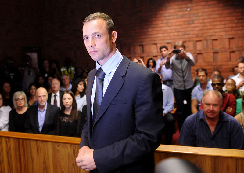 . Olympic athlete, Oscar Pistorius , in court Friday Feb. 22, 2013 in Pretoria, South Africa, for his bail hearing charged with the shooting death of his girlfriend, Reeva Steenkamp. The defense and prosecution both completed their arguments with the magistrate soon to rule if the double-amputee athlete can be freed before trial or if he must stay behind bars pending trial. (AP Photo/Antoine de Ras-Star)