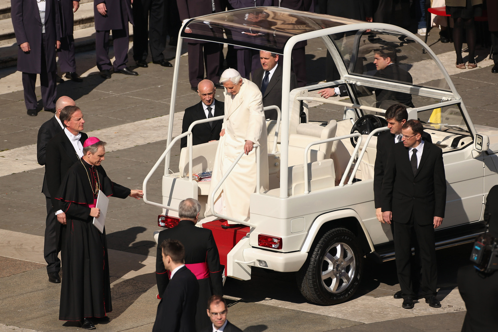 . Pope Benedict XVI disembarks the Popemobile in St Peter\'s Square on February 27, 2013 in Vatican City, Vatican.  The Pontiff has attended his last weekly public audience before stepping down tomorrow. Pope Benedict XVI has been the leader of the Catholic Church for eight years and is the first Pope to retire since 1415. He cites ailing health as his reason for retirement and will spend the rest of his life in solitude away from public engagements.  (Photo by Oli Scarff/Getty Images)