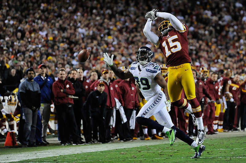 . Josh Morgan #15 fails to catch a pass thrown by  Robert Griffin III #10 of the Washington Redskins as  Brandon Browner #39 of the Seattle Seahawks defends during the NFC Wild Card Playoff Game at FedExField on January 6, 2013 in Landover, Maryland.  (Photo by Patrick McDermott/Getty Images)