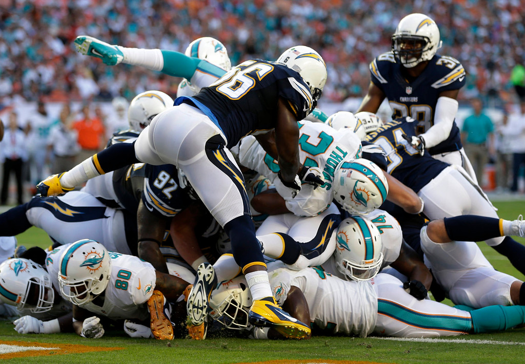 . Miami Dolphins running back Daniel Thomas (33) scores a one-yard touchdown during the first half of an NFL football game against the San Diego Chargers, Sunday, Nov. 17, 2013, in Miami Gardens, Fla. (AP Photo/Lynne Sladky)