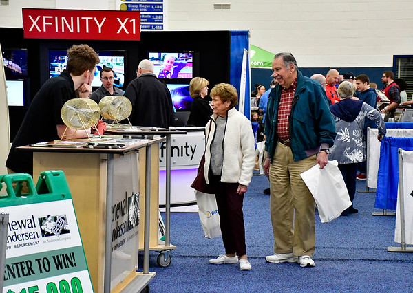 2/16/2019 Mike Orazzi | Staff Dory and Dick Avritch make the rounds during the 34th annual Bristol Home & Business Show at Bristol Eastern High School on Saturday.