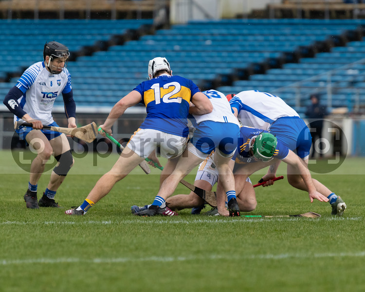 Tipperary's Niall O'Meara (12) and Noel McGrath (8) attempt to get the ball out of a ruck with Waterford's Darragh Lyons (19) and Peter Hogan (13) as Conor Gleeson looks on