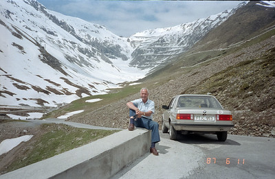 Appears we will be traveling over a not well travelled, minor mountain pass road.  Take the time now and follow this road as it hairpins over and over and over and then, over some more in the background, to eventually get us over this Alpine pass!