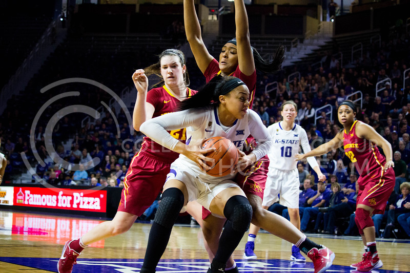 Freshman forward Eternati Willockholds blocks the opposite team and runs to score another win to the Cats during the K-State game against Iowa State in Bramlage Coliseum on Feb. 11 2017 where the Wildcats beat the Cardinals 80-68. (Alanud Alanazi | The Collegian)