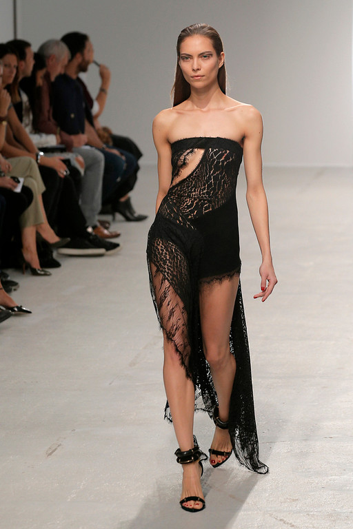 . A model presents a creation as part of Italian fashion designer Anthony Vaccarello\'s ready-to-wear Spring/Summer 2014 fashion collection presented in Paris, Tuesday, Sept. 24, 2013. (AP Photo/Christophe Ena)