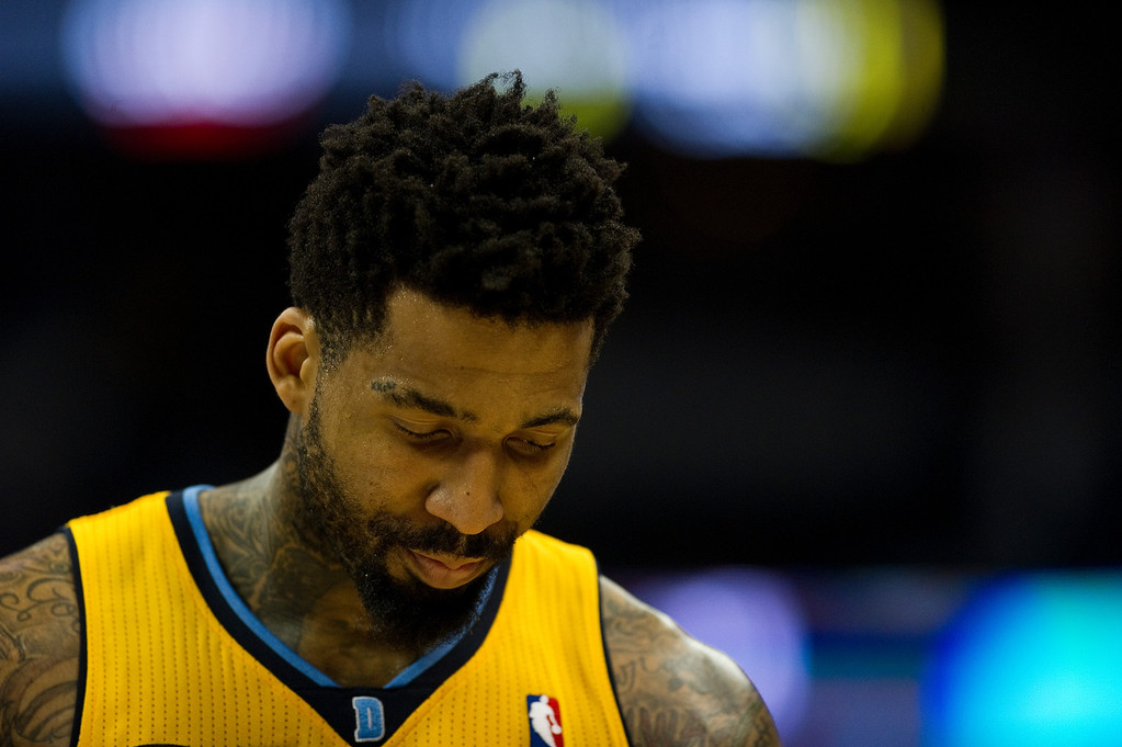 . DENVER, CO - DECEMBER 20: Wilson Chandler #21 of the Denver Nuggets walks off the court after the team lost to the Phoenix Suns at the Pepsi Center on December 20, 2013, in Denver, Colorado. The Suns won 103-99. (Photo by Daniel Petty/The Denver Post)