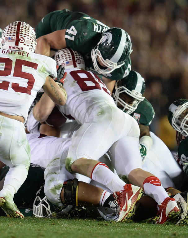 . Michigan State\'s Kyler Elsworth #41 goes over the top to stop Stanford\'s Ryan Hewitt #85 on 4th and 1 late in the 4th quarter during the 100th Rose Bowl game in Pasadena Wednesday, January 1, 2014. Michigan State defeated Stanford 24-20. (Photo by Hans Gutknecht/Los Angeles Daily News)