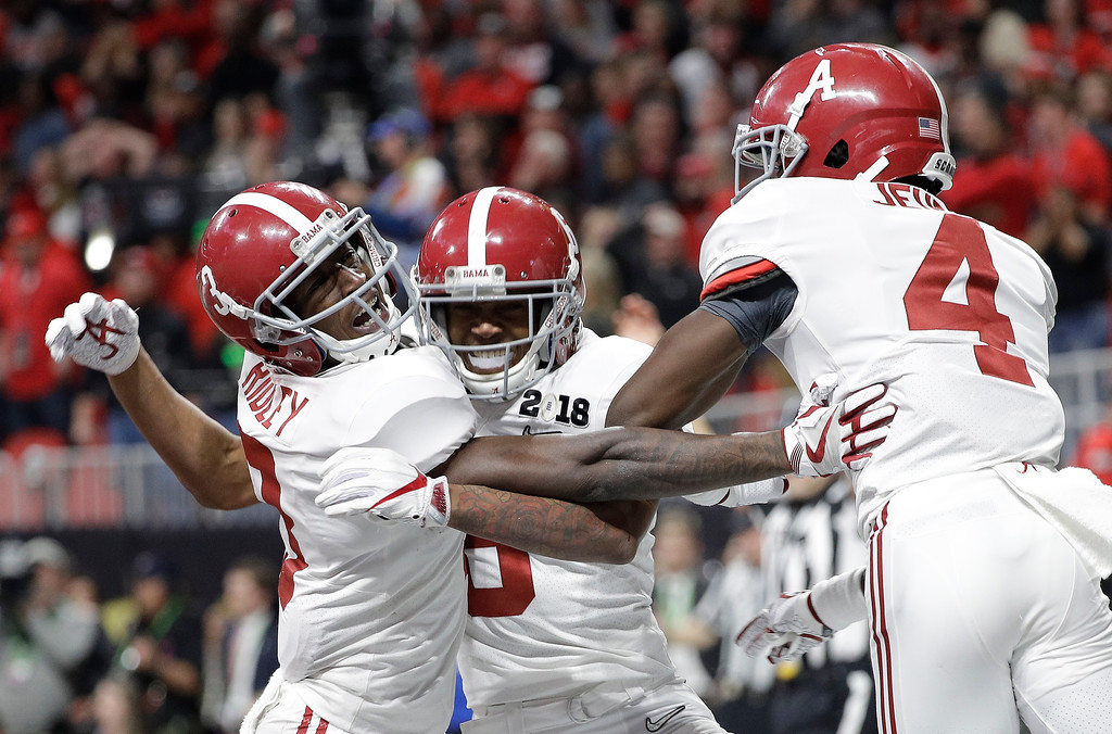 . Alabama wide receiver DeVonta Smith (6) celebrates his touchdown during overtime of the NCAA college football playoff championship game against Georgia, Monday, Jan. 8, 2018, in Atlanta. Alabama won 26-23 in overtime.(AP Photo/David J. Phillip)