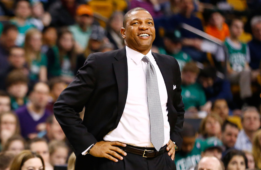 . BOSTON, MA - FEBRUARY 10: Head coach Doc Rivers of the Boston Celtics smiles as he watches his team play against the Denver Nuggets during the game on February 10, 2013 at TD Garden in Boston, Massachusetts.  (Photo by Jared Wickerham/Getty Images)