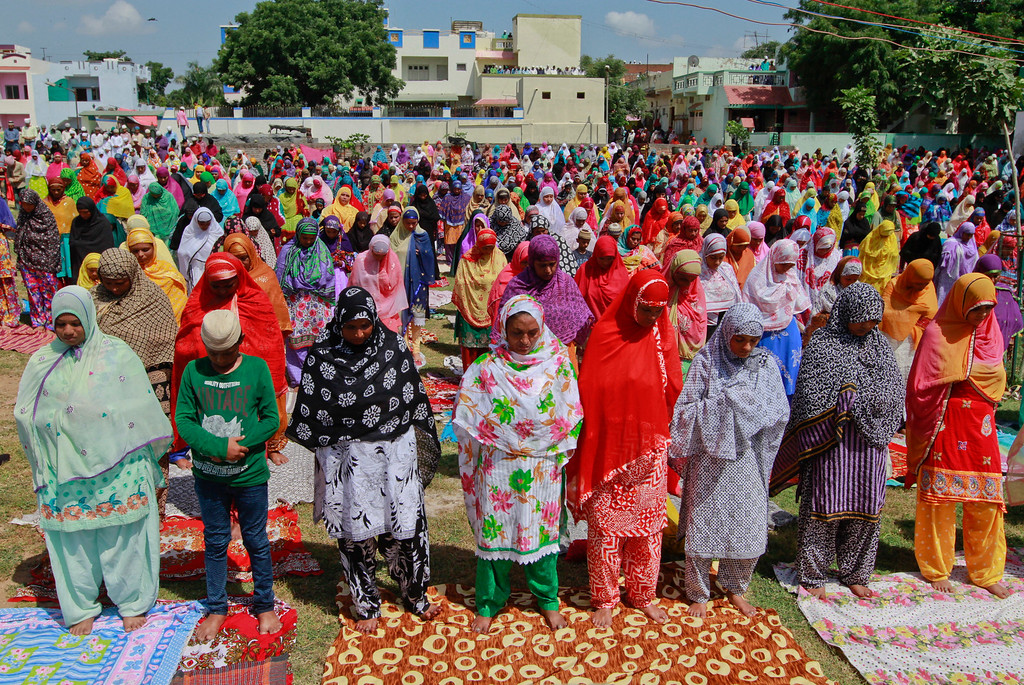 """. Indian Muslim women offer prayer on the eve of Eid al-Adha at a Mosque in Ahmadabad, India, Monday, Sept. 12, 2016. Muslims worldwide are celebrating Eid al-Adha, or \""""Feast of Sacrifice,\"""" the most important Islamic holiday that commemorates the willingness of the Prophet Ibrahim to sacrifice his son before God stayed his hand. During the holiday, Muslims slaughter livestock, distributing part of the meat to the poor. (AP Photo/Ajit Solanki)"""