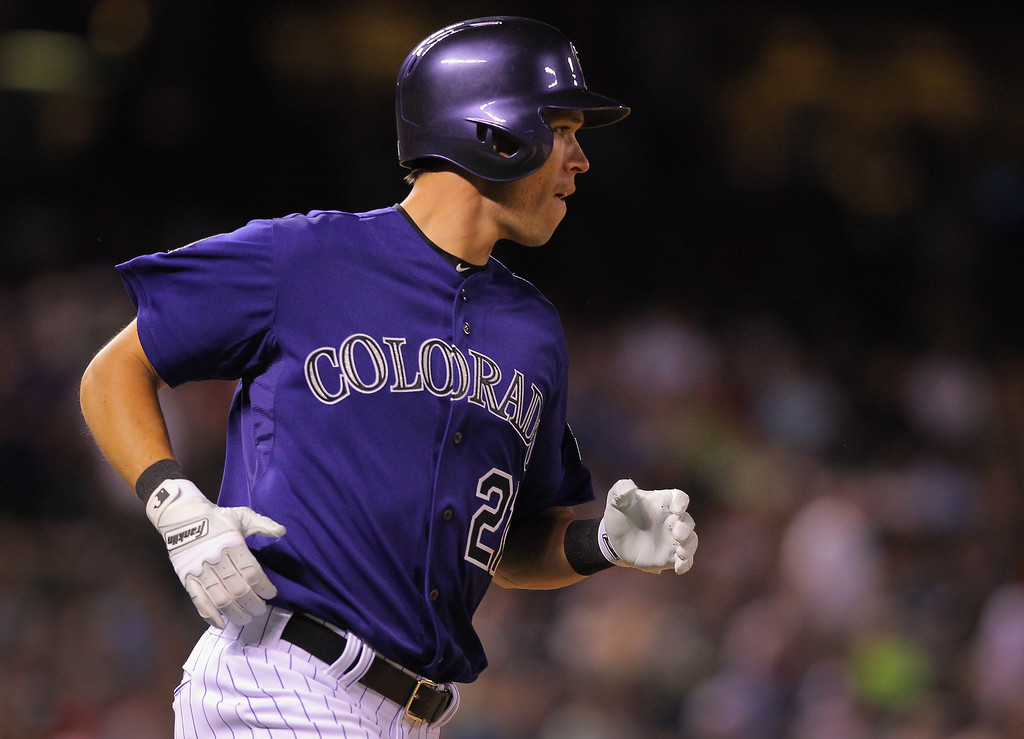 . Tyler Colvin #21 of the Colorado Rockies rounds the bases on his two run home run off of Drew Storen #22 of the Washington Nationals in the eighth inning at Coors Field on June 11, 2013 in Denver, Colorado. Colvin had two two run home runs in the game as the Rockies defeated the Nationals 8-3.  (Photo by Doug Pensinger/Getty Images)