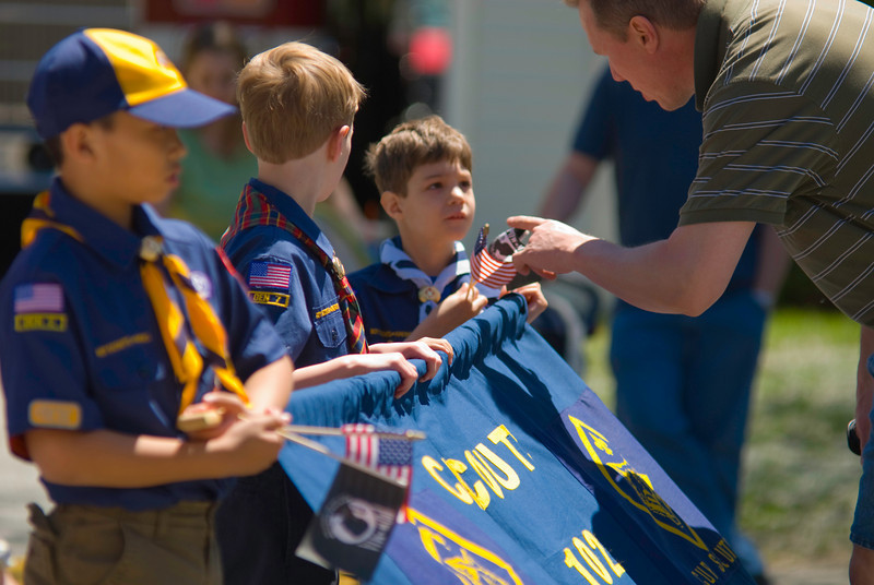 Pre-parade Instruction - The scoutmaster provides a few last minute instructions to the local cub scout troop.