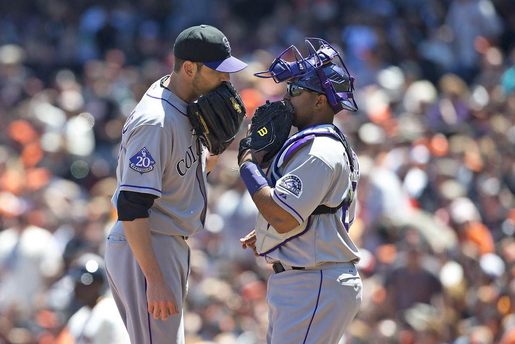 . Jon Garland #27 of the Colorado Rockies talks to Wilin Rosario #20 on the pitcher\'s mound against the San Francisco Giants during the second inning at AT&T Park on May 26, 2013 in San Francisco, California. (Photo by Jason O. Watson/Getty Images)
