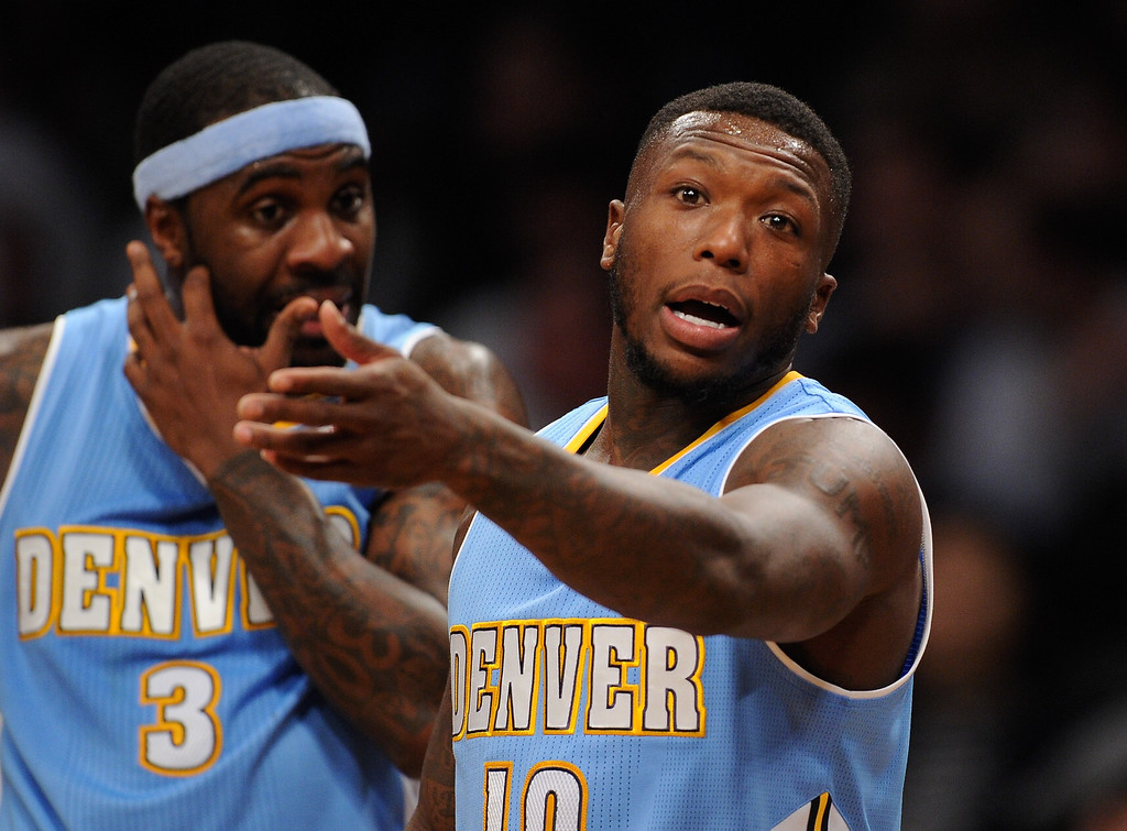 . NEW YORK, NY - DECEMBER 03:  Nate Robinson #10 of the Denver Nuggets disputes a call during the first half against the Brooklyn Nets at Barclays Center on December 3, 2013 in the Brooklyn borough of New York City. The Nuggets defeat the Nets 111-87. (Photo by Maddie Meyer/Getty Images)
