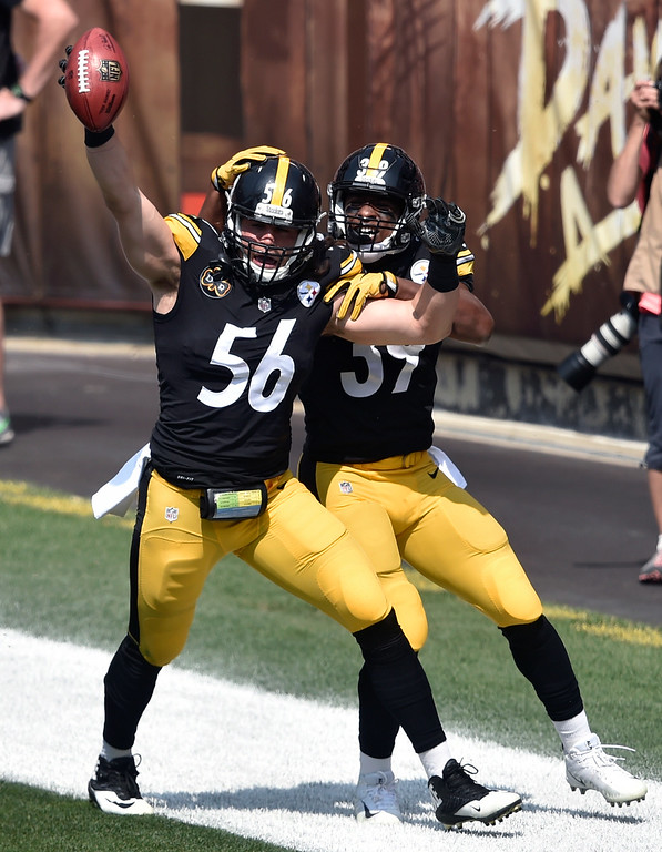 . Pittsburgh Steelers outside linebacker Anthony Chickillo (56) and running back Terrell Watson celebrate after Chickillo scored a touchdown during the first half of an NFL football game against the Cleveland Browns, Sunday, Sept. 10, 2017, in Cleveland. (AP Photo/David Richard)