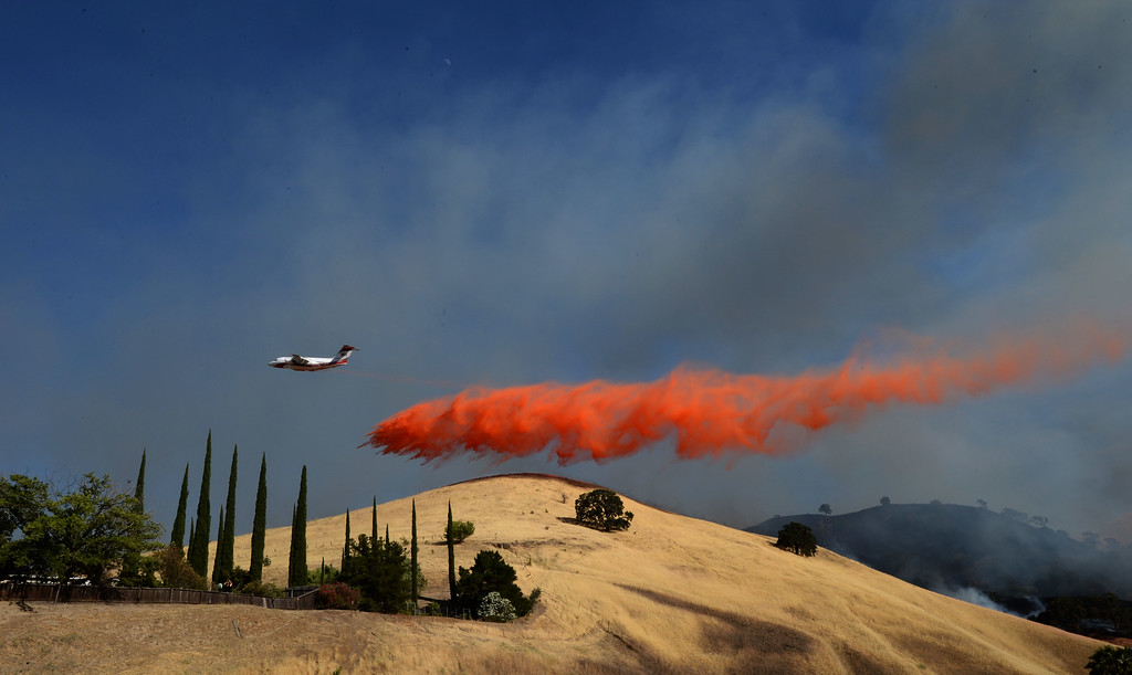 . Fire retardant is dropped on the hillside above Foothill Drrive near homes that have been evacuated in Antioch, Calif., on Wednesday, June 24, 2015. (Susan Tripp Pollard/Bay Area News Group)