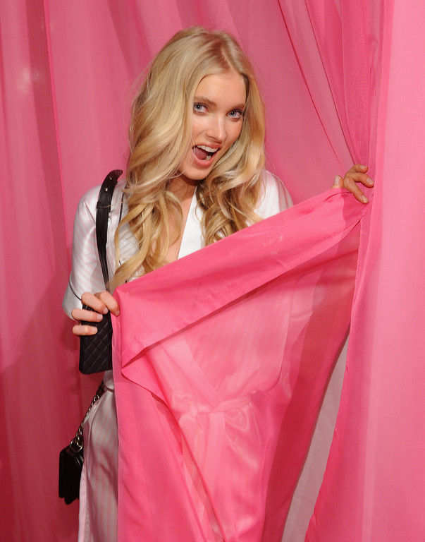 . Elsa Hosk prepares at the 2013 Victoria\'s Secret Fashion Show hair and makeup room at Lexington Avenue Armory on November 13, 2013 in New York City.  (Photo by Jamie McCarthy/Getty Images)