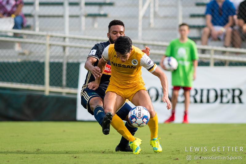 North Carolina FC defender D.J. Taylor (27) and Nashville SC defender Kosuke Kimura (27)