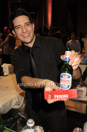 MIchael Chemas serves up a Peroni beer photo by Rob Rich/SocietyAllure.com © 2014 robwayne1@aol.com 516-676-3939