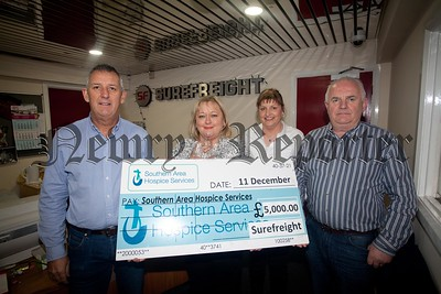 Fiona Stephens from Southern Area Hospice accepts a cheque for £5000 from Vincent Waddell, Brian McManus and Maureen McSwiggan at Surefrieght. Thsi is the Tenth consective year the company has donated to the Hospice which brings the total donation to £50,000. R1551013