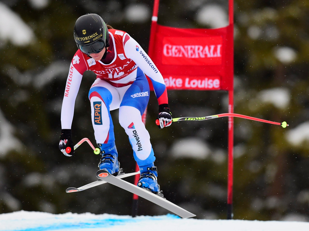 . Fabienne Suter, of Switzerland, races down the course during the women\'s World Cup downhill ski race in Lake Louise, Alberta, Saturday, Dec. 6, 2014. (AP Photo/The Canadian Press, Frank Gunn)